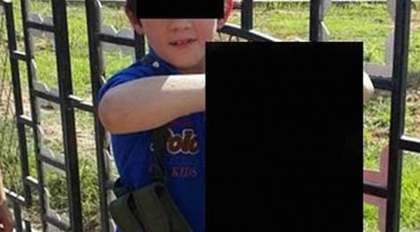 International outcry … A boy security agencies believe to be Australian Khaled Sharrouf's son holds the decapitated head of a soldier in the Syrian city of Raqqa. Source: Twitter